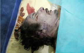 Strel v glavo pokončal Gadafija