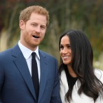 Britain\'s Prince Harry poses with Meghan Markle in the Sunken Garden of Kensington Palace