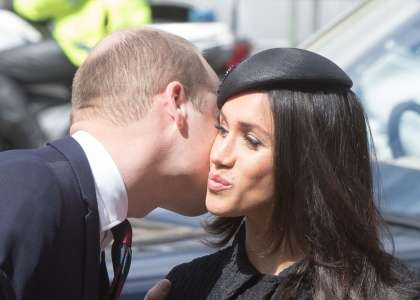 Princ William in Meghan Markle