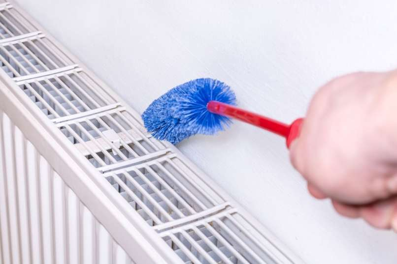 cleaning behind the radiator